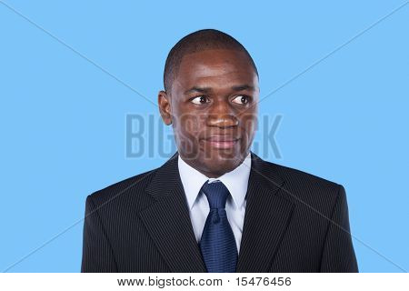 African businessman looking up with a suspicion expression