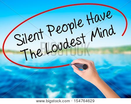 Woman Hand Writing Silent People Have The Loudest Mind With A Marker Over Transparent Board