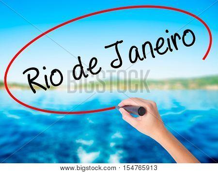 Woman Hand Writing Rio De Janeiro With A Marker Over Transparent Board