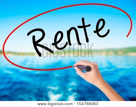 Woman Hand Writing Rente (pension In German) With A Marker Over Transparent Board.