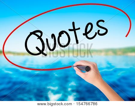 Woman Hand Writing Quotes  With A Marker Over Transparent Board