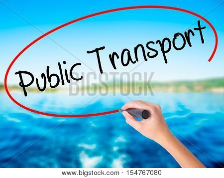 Woman Hand Writing Public Transport  With A Marker Over Transparent Board