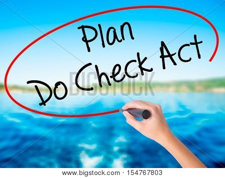 Woman Hand Writing Plan Do Check Act  With A Marker Over Transparent Board
