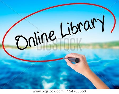 Woman Hand Writing Online Library With A Marker Over Transparent Board