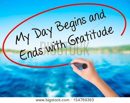 Woman Hand Writing My Day Begins And Ends With Gratitude With A Marker Over Transparent Board