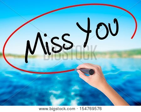 Woman Hand Writing Miss You With A Marker Over Transparent Board