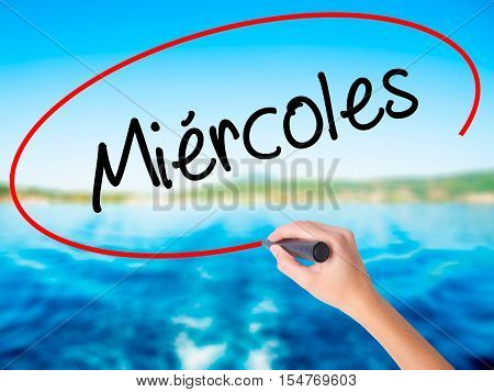 Woman Hand Writing Mi�©rcoles (wednesday In Spanish) With A Marker Over Transparent Board