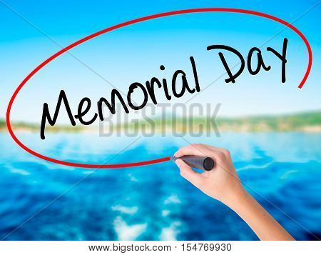 Woman Hand Writing Memorial Day With A Marker Over Transparent Board.
