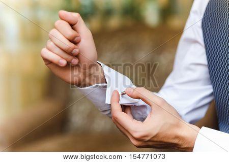 men wear cufflinks on a shirt sleeve