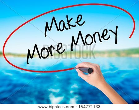 Woman Hand Writing Make Money Money  With A Marker Over Transparent Board