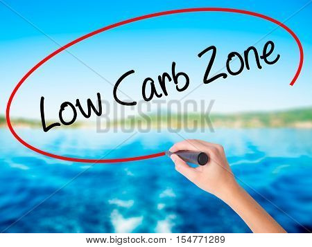 Woman Hand Writing Low Carb Zone With A Marker Over Transparent Board