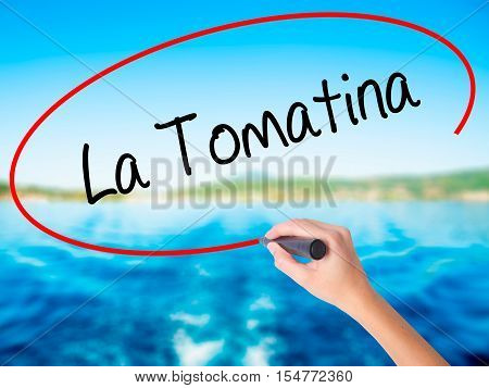 Woman Hand Writing La Tomatina With A Marker Over Transparent Board