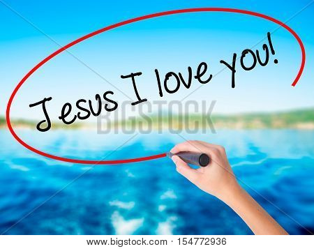 Woman Hand Writing Jesus I Love You! With A Marker Over Transparent Board