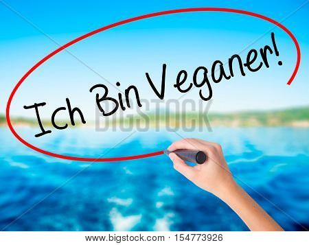 Woman Hand Writing Ich Bin Veganer! (im Vegetarian In German) With A Marker Over Transparent Board