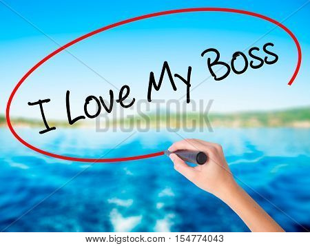 Woman Hand Writing I Love My Boss With A Marker Over Transparent Board