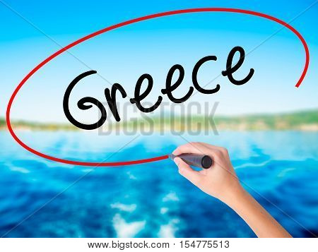 Woman Hand Writing Greece  With A Marker Over Transparent Board