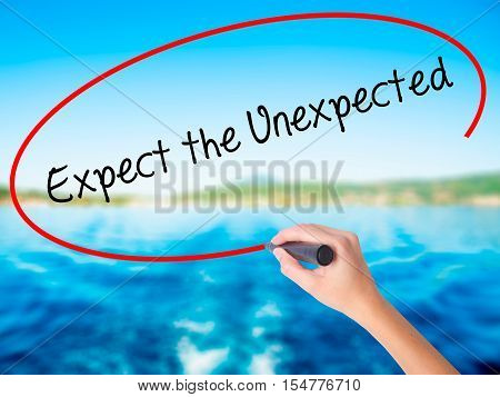 Woman Hand Writing Expect The Unexpected With A Marker Over Transparent Board