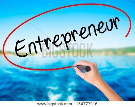 Woman Hand Writing Entrepreneur With A Marker Over Transparent Board