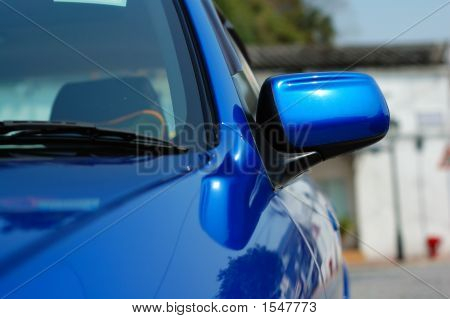 Right Side Mirror Of Shiny Blue Car