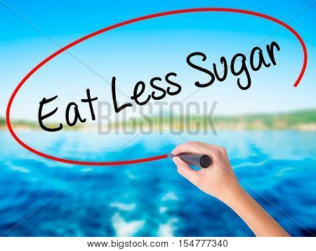 Woman Hand Writing Eat Less Sugar  With A Marker Over Transparent Board