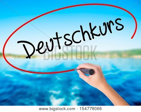 Woman Hand Writing Deutschkurs (german Course In German) With A Marker Over Transparent Board