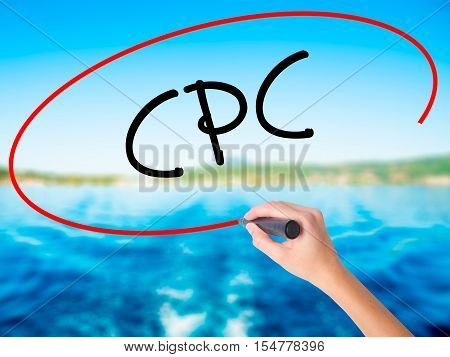 Woman Hand Writing Cpc (cost Per Click)  With A Marker Over Transparent Board