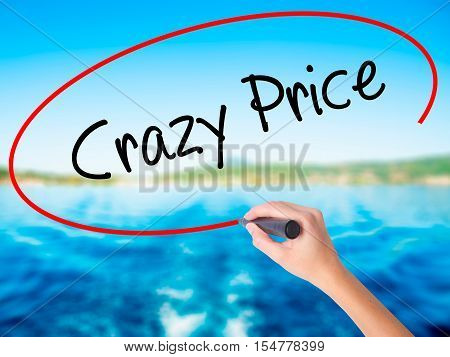 Woman Hand Writing Crazy Price With A Marker Over Transparent Board