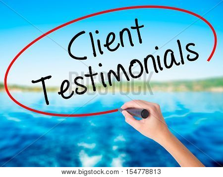 Woman Hand Writing Client Testimonials With A Marker Over Transparent Board
