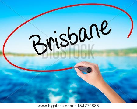 Woman Hand Writing Brisbane  With A Marker Over Transparent Board