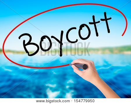 Woman Hand Writing Boycott With A Marker Over Transparent Board.