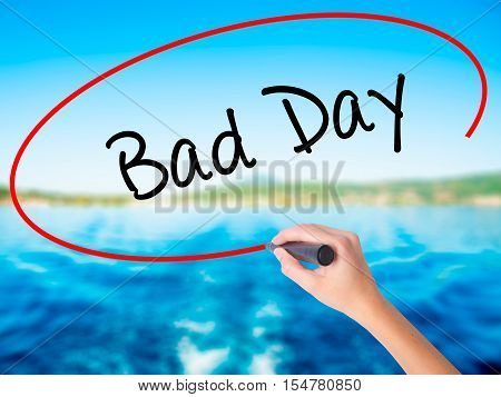 Woman Hand Writing Bad Day  With A Marker Over Transparent Board