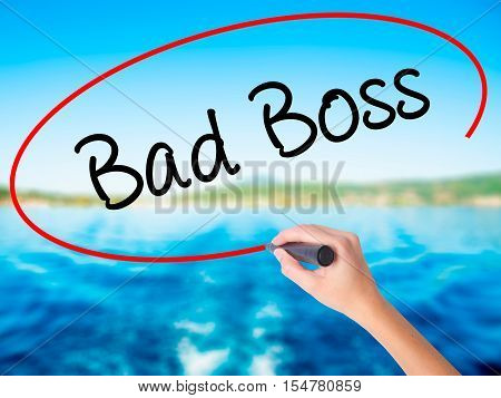 Woman Hand Writing Bad Boss With A Marker Over Transparent Board
