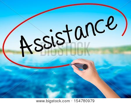 Woman Hand Writing Assistance With A Marker Over Transparent Board