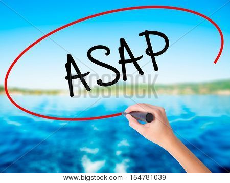 Woman Hand Writing Asap  With A Marker Over Transparent Board