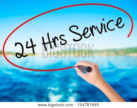 Woman Hand Writing 24 Hrs Service With A Marker Over Transparent Board