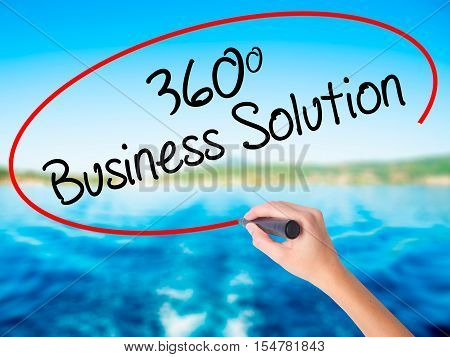 Woman Hand Writing 360 Business Solution With A Marker Over Transparent Board