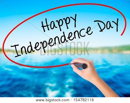 Woman Hand Writing Happy Independence Day With A Marker Over Transparent Board