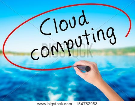 Woman Hand Writing Cloud Computing With A Marker Over Transparent Board