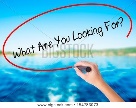Woman Hand Writing What Are You Looking For? With A Marker Over Transparent Board