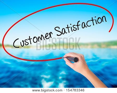Woman Hand Writing Customer Satisfaction With A Marker Over Transparent Board