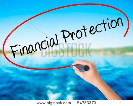 Woman Hand Writing Financial Protection With A Marker Over Transparent Board