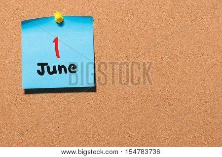 June 1st. Day 1 of month, color sticker calendar on notice board. Summer time. Empty space for text.