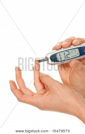 Diabetes Patient Making Glucose Blood Level Test