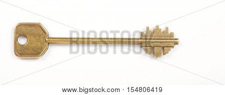 old brass key on white background