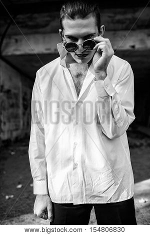 crazy guy in a white shirt and round glasses