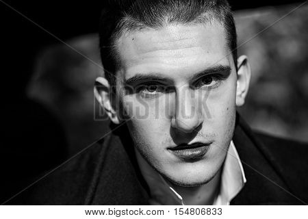 brutal sexy young man with black lips