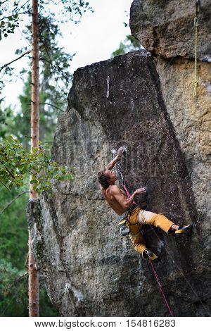 Extreme sport climbing. Rock climber struggle for success. Copy space.