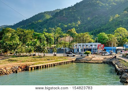 Koh Chang, Thailand - December 10, 2015: Port ferry boat with concrete ferry pier. The arrival of the ferry. A taxi waits for tourists to take them to different places around the island