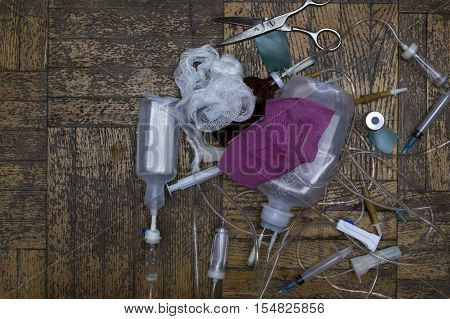 Bunch of used medical supplies laid on the floor overhead shot