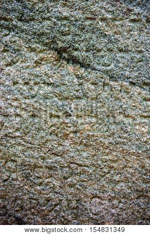 Granite surface of the Jewish gravestone with the inscription.